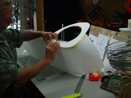 Shaping and Taping 1/16 inch foam panels around eye openings.