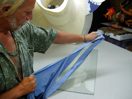 Tearing cotton sheets into strips. Cloth is a much stronger material to use for a base coat.
