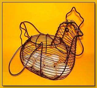 """Speckled Paper Mache Eggs in a Wire Hen Basket"" by Tammy Wilson"