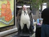 Life-size penguin at comic convention by Art Lopez