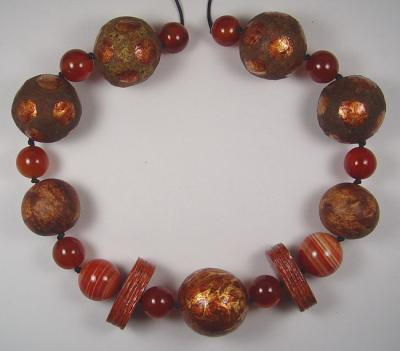 """Rust coloured papier mache bead necklace"" by Evangeline Duplessis"