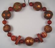 Rust coloured papier mache bead necklace by Evangeline Duplessis