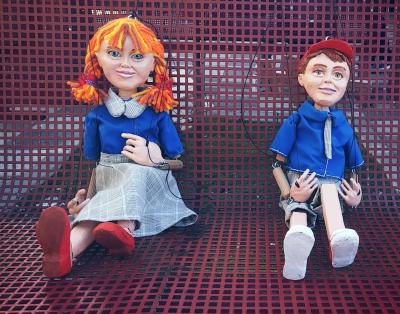 """Boy and Girl Marionette"" by Eva Goldman"