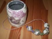 Floral necklace and pot by Catherine Kirkwood