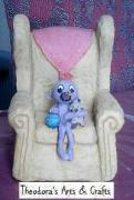 Cutie Baby On Sofa Chair by Theodora Spanides