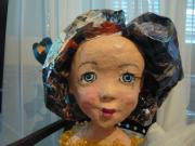 head of a doll (she has a body' too} by Tiva Noff